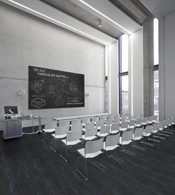 Manchester School of Art at MMU, Manchester, United Kingdom. Architect: Feilden Clegg Bradley Studios LLP, 2014. View into empty lecture hall.